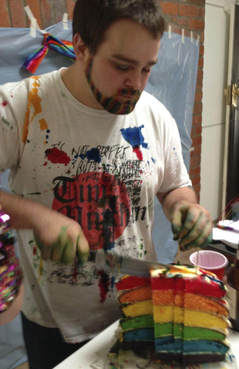 Damian cuts cake